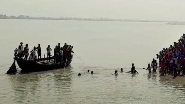 Rescue operations underway after a boat capsized in the Naugachhia area of Bhagalpur district on Thursday.(PTI Photo)