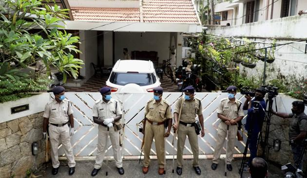Security personnel stand guard outside the residence of Bineesh Kodiyeri on Wednesday.(PTI)