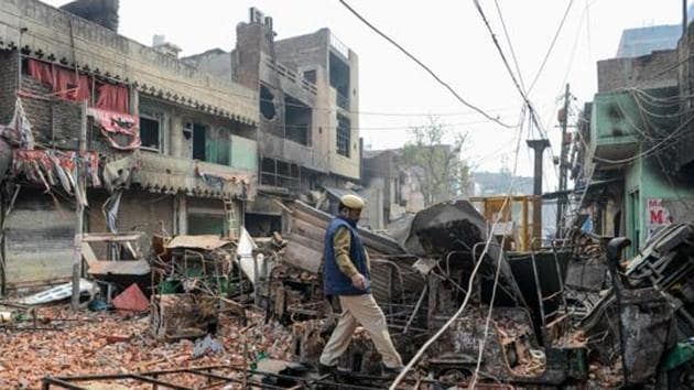 A security personnel patrols damaged residential premises and shops following the clashes in New Delhi.(File photo)