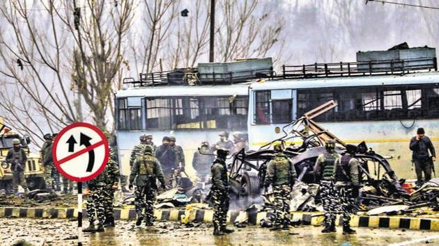 Security personnel carry out the rescue and relief works at the site of suicide bomb attack at Lathepora, Awantipora in Pulwama district of south Kashmir, Thursday, February 14, 2019.(PTI File)