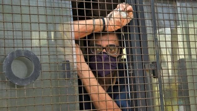 Arnab Goswami, Republic TV editor-in- chief, sits inside a police van outside a court after he was arrested, at Alibaug town in Maharashtra, November 4, 2020.(Reuters photo)