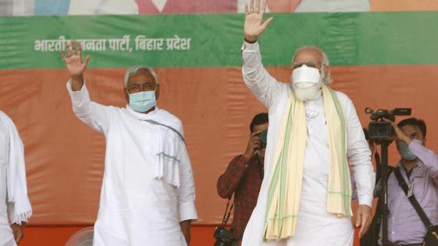 Prime Minister Narendra Modi with JDU national president and Bihar Chief Minister Nitish Kumar during an election rally in Bhagalpur, Bihar.(Santosh Kumar/ Hindustan Times)