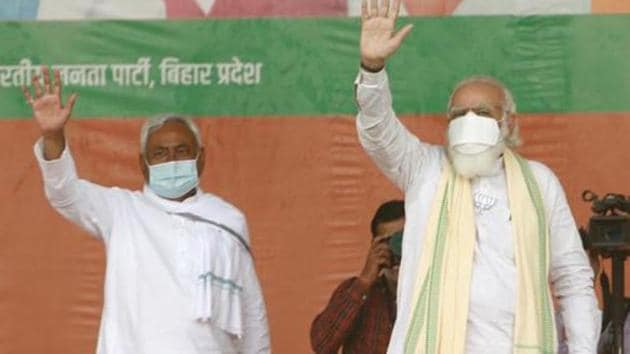 Prime Minister Narendra Modi with JDU national president and Bihar Chief Minister Nitish Kumar during an election rally.(HT filephoto)