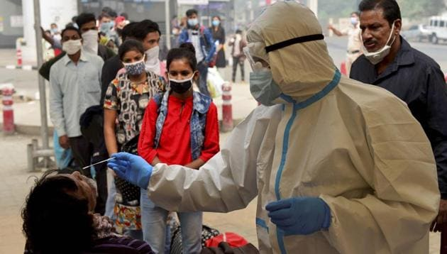 A health worker conducts Covid-19 RAT test at Anand Vihar Bus Terminal, as coronavirus cases surge across the national capital, in New Delhi.(PTI)