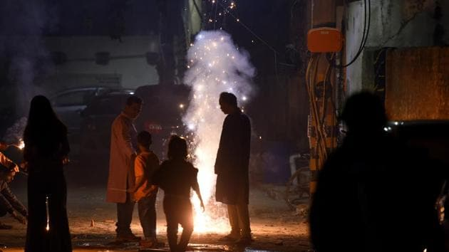 A file photo of people bursting crackers is relevant even two years later. Delhi remains engulfed in a haze as pollution levels increase.(PHOTO: Amal KS/HT)