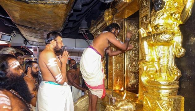 Priests perform rituals for the 'Tulamas Puja' at the Sabarimala temple, in Pathanamthitta district.(PTI)