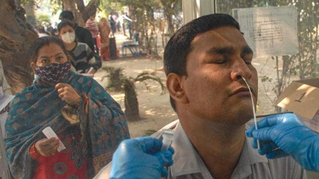 Noida: A medic takes a nasal sample from a man for COVID-19 test, at a district hospital in Noida, Saturday, Nov. 7, 2020.(PTI)