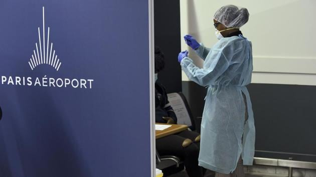 A health worker uses a cotton swab to test a person for coronavirus infection at Orly airport near Paris on November 6. In addition to lockdown measures, French Health Minister Olivier Veran also announced on November 6, that the government had sanctioned 1.6 million rapid virus testing kits for care homes across the country, to ramp up testing and tracking. (Eric Piermont / AFP)