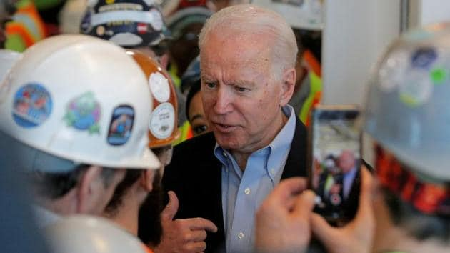 US President elect and former Vice President Joe Biden argues with a worker about his gun control policies during a Biden campaign stop at the FCA (Fiat Chrysler Automobiles) Mack Assembly plant in Detroit, Michigan, US, March 10, 2020 (REUTERS/Brendan McDermid/File Photo)
