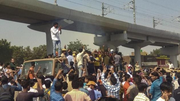 People block Agra National Highway road as they stage a protest demanding justice for Nikita, who was shot dead in Ballabhgarh a few days ago, at Ballabhgarh in Faridabad district, Sunday, Nov. 1, 2020.(PTI)
