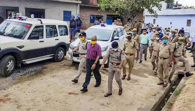 A Special Investigation Team (SIT) at Bikru village near Kanpur where eight policemen were killed by gangster Vikas Dubey on July 3.(PTI FILE PHOTO)
