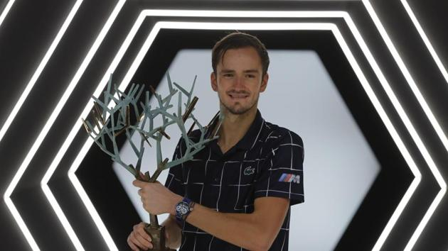 Russia's Daniil Medvedev poses with his trophy after the Paris Masters tennis tournament final, Sunday, Nov. 8, 2020 in Paris. Daniil Medvedev won the Paris Masters for the first time by beating Germany's Alexander Zverev 5-7, 6-4, 6-1 on Sunday for his eighth career title and third at a Masters event.(AP)