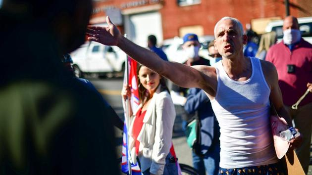 A supporter of Donald Trump argues with a supporter of Joe Biden after news media named Biden the winner in the presidential election, in Philadelphia on November 7. Many supporters of Trump and his running mate, Vice President Mike Pence, demonstrated their own unwillingness to accept the election's outcome. (Mark Markela / REUTERS)