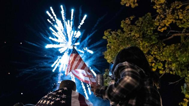 Supporters of US President-elect Joe Biden watch fireworks as they celebrate near the White House on November 7 in Washington, D.C. (Alex Edelman / AFP)