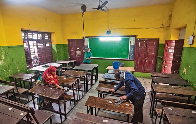 Workers clean classrooms at Katariya school, Gultekdi in Pune, India, on Monday.(Pratham Gokhale/HT Photo)