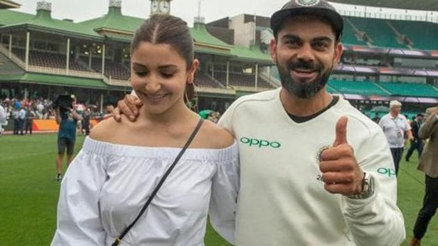 India's captain Virat Kohli celebrates with his wife Anushka Sharma after winning the series 2-1 following play being abandoned on day five in the fourth test match between Australia and India at the SCG in Sydney, Australia, January 7, 2019.(REUTERS)