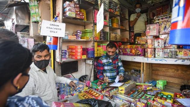 People buy firecrackers from a shop ahead of Diwali at Sadar Bazar, in New Delhi on November 3.(Amal KS/HT PHOTO)