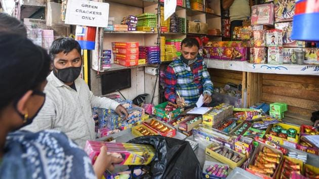 People look to buy firecrackers from a shop ahead of Diwali festival at Sadar bazar, in New Delhi on November 3, 2020.(Amal KS/HT Photo)