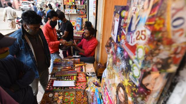 """Customers look to buy green crackers ahead of Diwali at Dariba Kalan in New Delhi on November 5. Meanwhile, taking the matters into its hands, the NGT ordered that except for Delhi-NCR, the ban will be applicable in cities and towns where the air quality is in """"poor"""" category, news agency ANI reported. (Raj K Raj / HT Photo)"""