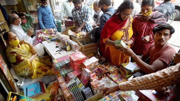 New Delhi: People visit a firecrackers' shop, ahead of Diwali, near Jama Masjid in old Delhi, Friday, Nov. 6, 2020 (PTI Photo/Kamal Singh)