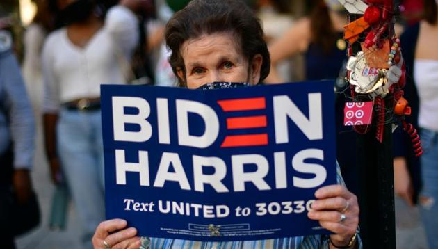 A Biden supporter holds a campaign sign, the day after a presidential election victory was called for former Vice President Joe Biden, in Philadelphia, Pennsylvania, US on November 8, 2020.(Reuters Photo)