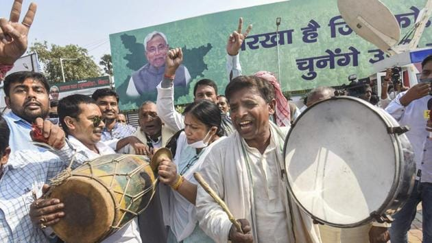 Janata Dal (United) supporters in a celebratory mood on counting day, in Patna on November 10. Despite the slump in numbers to 43 from 71 in 2015, Nitish Kumar, who was declared the NDA's chief ministerial candidate by BJP brass, including Prime Minister Narendra Modi and party chief J P Nadda, is set to take over the reins of the government for a fourth term. (PTI)