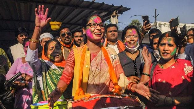 BJP supporters react as results unfold on counting day of Bihar Assembly polls, in Patna on November 10. The National Democratic Alliance (NDA) at 124 seats emerged as the big gainer on what turned out to be a drawn out counting day. The alliance scraped past the majority mark of 122 seats with the Bharatiya Janata Party (BJP) finishing with 74 seats and the JDU 43. (PTI)