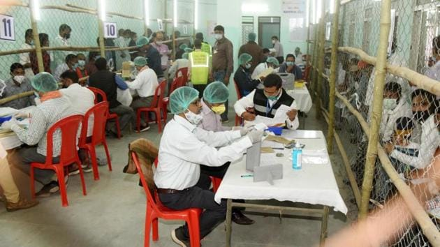 Election officials counting votes at a polling centre in Patna on November 10. Through the day the BJP appeared set to leave its ally JD (U) far behind in the seat tally, emerging as the senior partner in the alliance for the first time in about two decades. (Santosh Kumar / HT Photo)