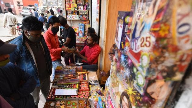 Customers look to buy green crackers ahead of Diwali festival, at Dariba Kalan, in New Delhi.(Raj K Raj/HT PHOTO)