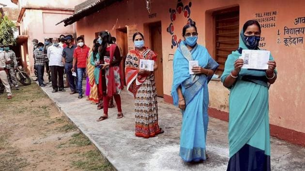 Women show their fingers marked with indelible ink after casting vote during the Jharkhand Assembly bypolls, amid the ongoing coronavirus pandemic, in Dumka district, Tuesday on Nov. 3, 2020.(PTI File Photo)