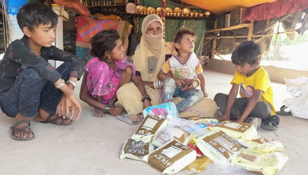 A family with a Diwali happiness kit.(HT PHOTO)
