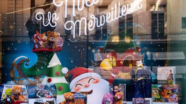 """A view of a toy shop window with an inscription reading """" A wonderful Christmas"""" in Paris, France on November 10. Broad lockdowns earlier this year had helped Europe control the pandemic significantly but case numbers have surged since the summer and governments have ordered a second series of restrictions to limit social contacts. (Joel Saget / AFP)"""