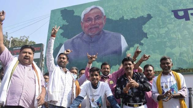 Supporters of the Janata Dal (United) celebrate the Bihar assembly poll results in Patna on Tuesday.(AP)