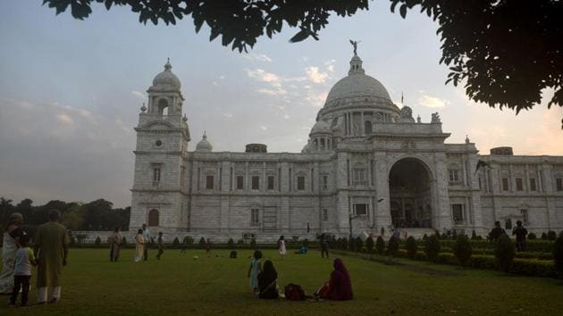 Visitors in the lawns at Victoria Memorial Hall in Kolkata on the day it reopened to the public. Victoria Memorial was on the other hand pushing for contactless online ticketing with physical tickets available for those without smartphones. A cap of 500 visitors at a time has also been placed on the lawns. (Samir Jana / HT Photo)