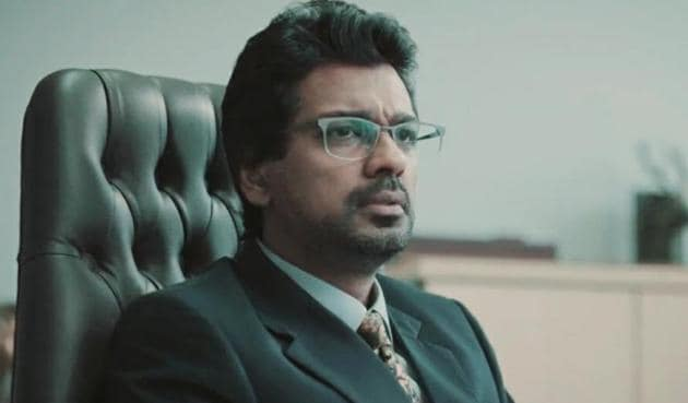Nikhil Dwivedi as Tyagi in Scam 1992.