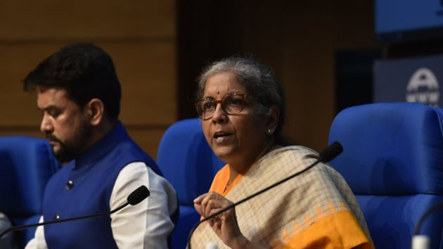 Union finance minister Nirmala Sitharaman along with minister of state for finance Anurag Thakur address a press conference at National Media Centre, in New Delhi.(Sanjeev Verma/HT Photo)