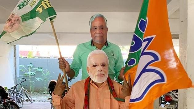 NDA supporters wearing masks of CM Nitish Kumar and PM Narendra Modi celebrate the alliance's leads on counting day of Bihar Assembly polls, in Patna.(Santosh Kumar/ Hindustan Times)