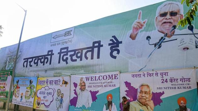 Poster of Janta Dal (United) President and Bihar Chief Minister Nitish Kumar put up by workers after NDA's victory in Bihar Assembly election, in Patna, Wednesday.(PTI File Photo)
