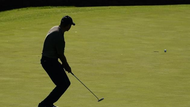 Tiger Woods watches his missed putt on the 11th hole during the first round of the Masters golf tournament Thursday, Nov. 12, 2020, in Augusta, Ga. (AP Photo/Charlie Riedel)(AP)