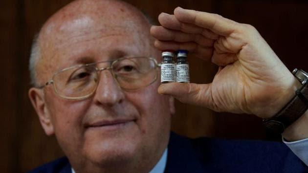 Alexander Gintsburg, director of the Gamaleya National Research Center for Epidemiology and Microbiology, shows bottles with Sputnik-V vaccine against the coronavirus disease (COVID-19) during an interview with Reuters.(REUTERS)