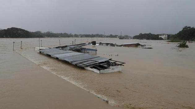 Submerged structures are seen at a swollen river as floods continue to rise in Marikina, Philippines due to Typhoon Vamco on November 12. Nearly 200,000 people were evacuated before Vamco arrived late on Wednesday packing winds of 155 kilometres (96 miles) per hour and gusts of up to 255 kph (158 mph). It has since weakened and exited the mainland. (Aaron Favila / AP)