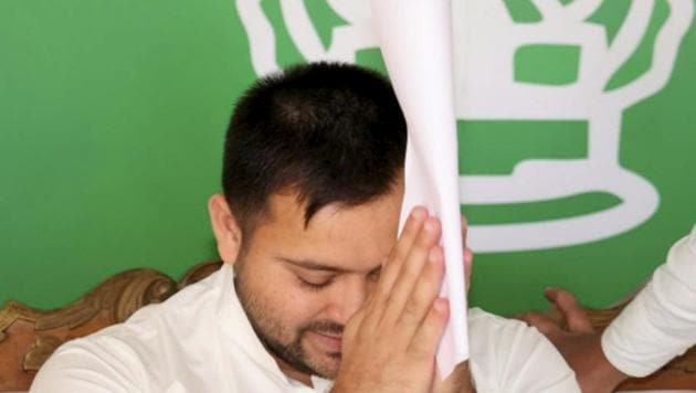 RJD leader Tejashwi Yadav attends the party legislators' meeting in Patna on Thursday.(PTI)