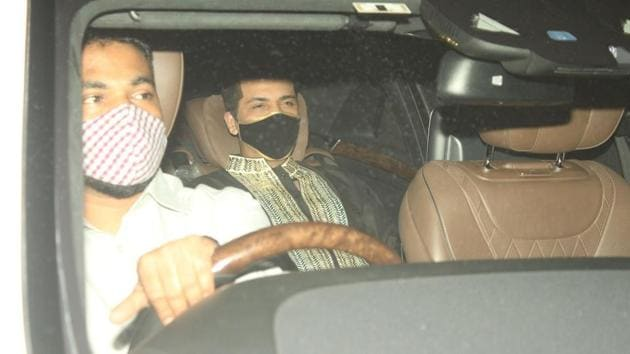 Karan Johar arriving at Ekta Kapoor's house.