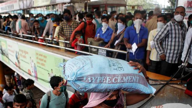 Migrants who returned from their hometown of Uttar Pradesh arrive to wait in line to be tested for the coronavirus disease (COVID-19) during a rapid antigen testing campaign at a railway station, on the outskirts of Mumbai.(REUTERS File)