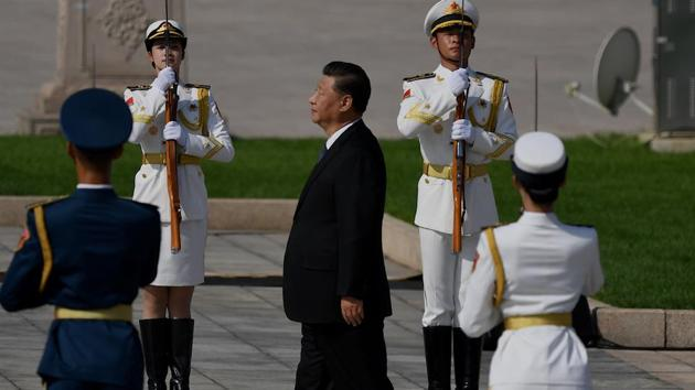 Chinese President Xi Jinping walks to the Monument to the People's Heroes during a wreath laying ceremony to honour deceased national heroes on Martyrs' Day in Beijing's Tiananmen Square on September 30, 2020(AFP/File)