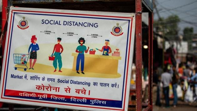 A Covid-19 safety awareness board displayed at Lajpat Nagar market in New Delhi on November 13. Delhi saw a surge in the number of cases over the fortnight, recording over 5,000 cases each day except on a Sunday, HT reported. (Prashanth Vishwanthan / Bloomberg)