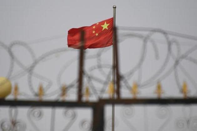 """The Uyghur Muslims in Chinese """"re-education"""" camps are forced to eat pork every Friday, confirmed Sayragul Sautbay, who was one of the victims of the atrocities being committed by the Chinese government(AFP)"""