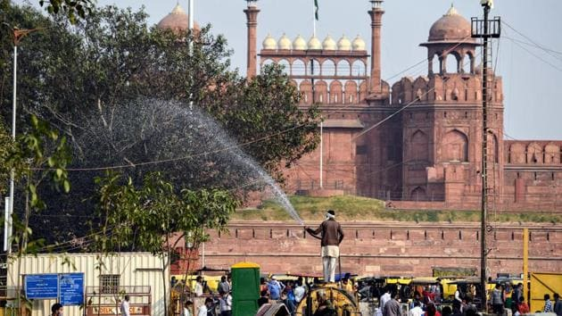 A municipal worker sprinkles water on trees and roads to reduce dust pollution at Chandni Chowk on November 13. SAFAR, under the Indian Institute of Tropical Meteorology, has also released a similar forecast for Delhi's air quality for the Diwali weekend, HT reported. (ANI)