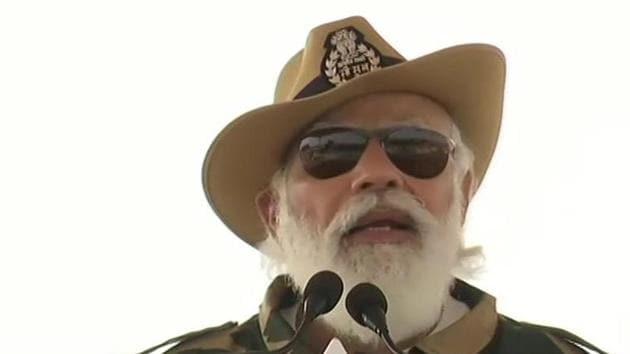 Prime Minister Narendra Modi addressing the soldiers in Rajasthan Longewala on Saturday.(ANI Photo)