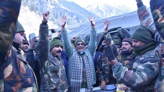 Uttarakhand Chief Minister Trivendra Singh Rawat with army soldiers at Harsil valley in Uttarkashi district.(Uttarakhand CMO)
